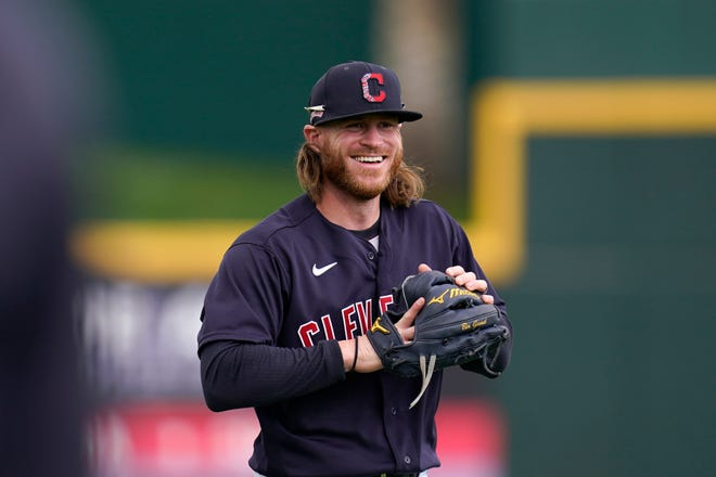 Cleveland Indians' Ben Gamel warms up prior to a spring training baseball game against the San Francisco Giants Tuesday, March 23, 2021, in Goodyear, Ariz. (AP Photo/Ross D. Franklin)