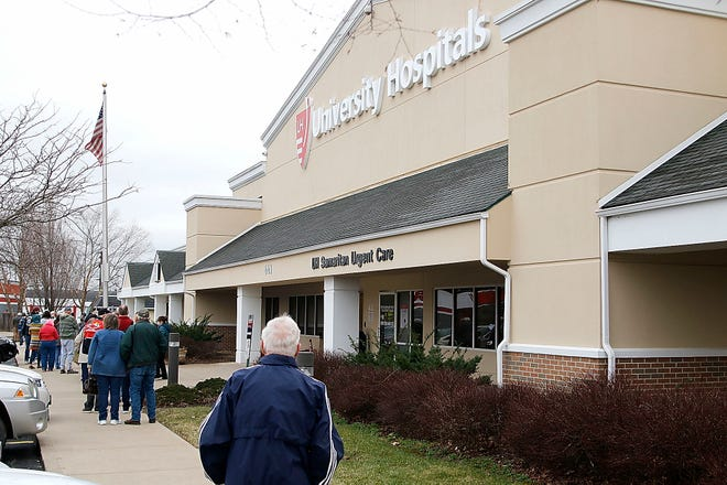 A line forms outside University Hospitals Samaritan on Main Friday when the hospital opens a COVD-19 vaccination clinic for anyone 16 and over.