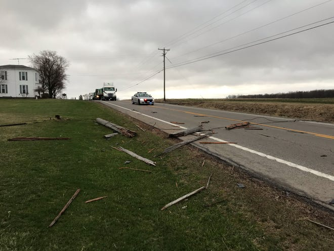 High winds brought down a utility pole that was then struck by a vehicle on U.S. Route 250 Friday morning. The incident had traffic backed up in both directions.