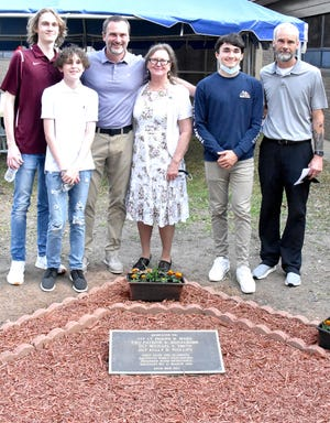 The Maks family stands behind the monument unveiled March 15 as part of the rededication ceremony of the Polk Army Airfield Operation's building.