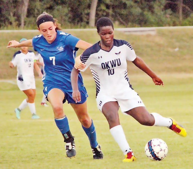 Marjolen Nekesa, right, goes on the attack for the women's soccer team of Oklahoma Wesleyan University during a previous season.