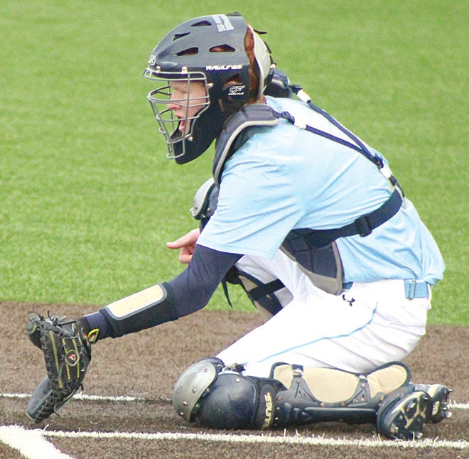Eric Olenberger prepares to snare a low pitch during Bartlesville High baseball action.