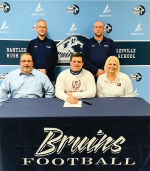 Bartlesville High senior football player Colton Green, center, inks his letter of intent to play football for Evangel (Mo.) University. Standings, from left, are Bartlesville head football coach Jason Sport and assistant Harley Rutherford. Seated are Green's parents Brad and Margie.