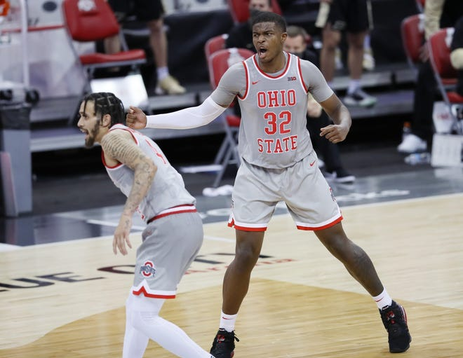Ohio State Buckeyes forward E.J. Liddell (32) celebrates a three pointer with guard Duane Washington Jr. (4) during the second half of the men's basketball game against the Purdue Boilermakers at Value City Arena in Columbus on Tuesday, Jan. 19, 2021. Purdue won 67-65.