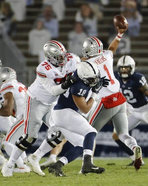 Thayer Munford (75) came to Ohio State as a low-rated recruit but by 2020 had blossomed into an NFL prospect, allowing no sacks and committing no penalties last season.
