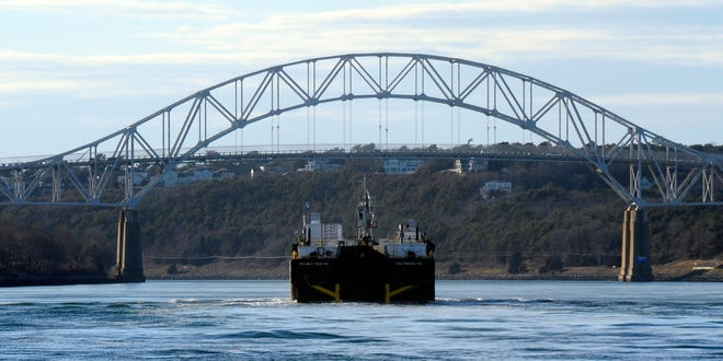 A barge in the Cape Cod Canal is towed by the tugboat Pocomoke toward the Sagamore Bridge in 2017. While it is possible, it is also highly unlikely that a much-larger ship would get stuck sideways in the canal, according to Joe Mazzola, of the U.S. Army Corps of Engineers.