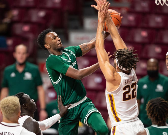 Green Bay guard Amari Davis (1) drives to the basket against Minnesota during a game Nov. 25 at Williams Arena in Minneapolis.