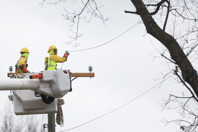 A crew from a private contracting firm works to restore power to Bexley residents along Dale Avenue Friday morning after a wind storm hit the area.