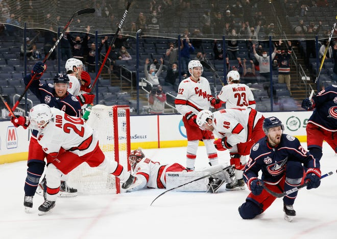 Blue Jackets forward Oliver Bjorkstrand (28) and his teammates celebrate his game-tying goal with 15.1 seconds in regulation on Thursday. The Jackets lost in overtime but grabbed five of eight possible points in their four games against Carolina.