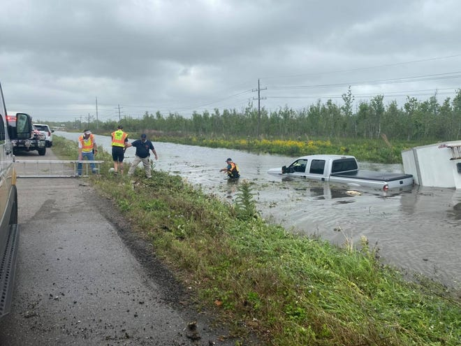 The Coteau Fire Department rescues a driver who became trapped in a Terrebonne Parish waterway Thursday.