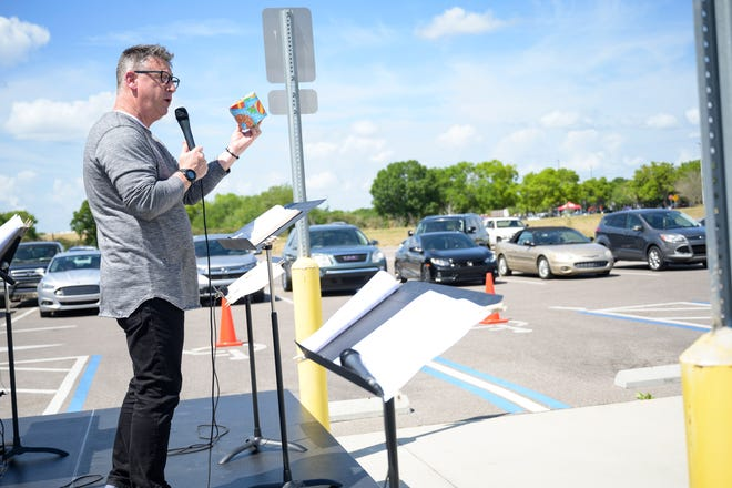 Pastor David Miller of The Fellowship Church in Leesburg gives a live sermon at Drive-in Church in front of Epic Theaters in Mount Dora on Sunday, March 22, 2020. For Easter this year, the church is hosting in-person services and broadcasting them. [Cindy Peterson/Correspondent]