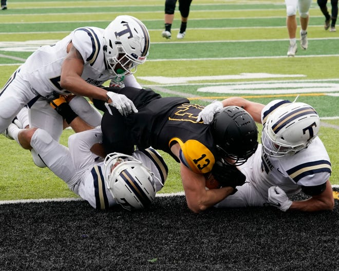 Adrian College's Gage Palus dives into the endzone during a game against Trine on Oct. 3 at Docking Stadium.