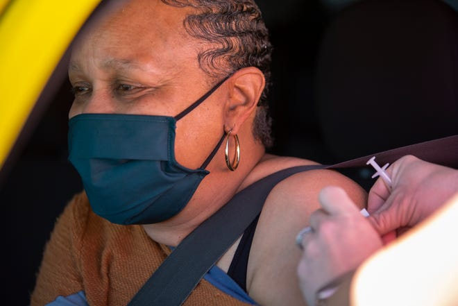 Nurse Leigh Jones administers a COVID-19 vaccination to Kim Winfrey at a vaccination event hosted by the Maury Regional Health Mobile Medical Unit at St. Paul AME Church in Columbia, Tenn., on Friday, March 26, 2021.