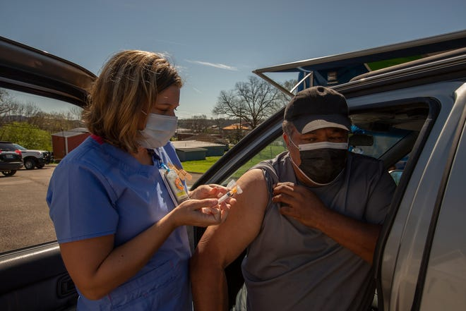Nurse Leigh Jones administers a COVID-19 vaccination to Thomas Martin at a vaccination event hosted by the Maury Regional Health Mobile Medical Unit at St. Paul AME Church in Columbia, Tenn., on Friday, March 26, 2021.