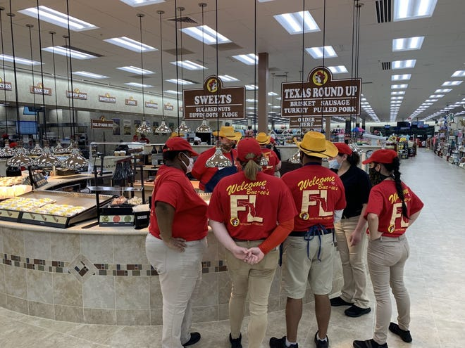 Buc-ee's employees get last-minute instructions shortly before the Daytona Beach supersized convenience store/gas station opened its doors to the public 6 a.m. Monday, March 22, 2021.