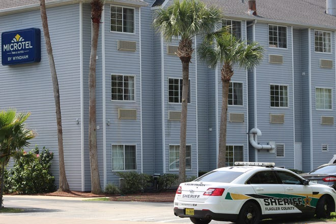 The Flagler County Sheriff's Office was at the Microtel hotel in Palm Coast on Friday investigating a case in which a woman was shot. Deputies were also at Graham Swamp as part of the same investigation.