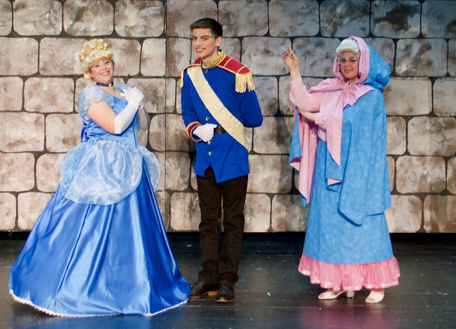 From left, Rhonda Fenkner, Cinderella, student director, and Drama Club secretary; Alex Taylor, Prince Charming and Drama Club president; and Lily Visceglia, Fairy Godmother, student director, and Drama Club vice president.  Please note that all students are wearing face shields in photograph.