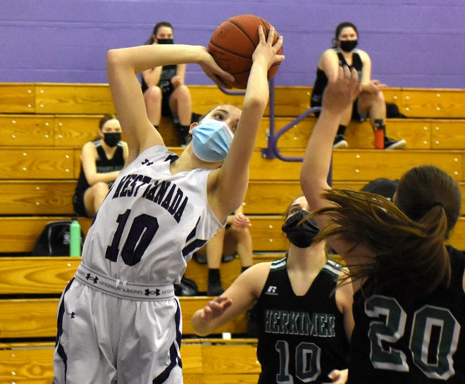 Lydia Reimer (10) grabs a rebound for West Canada Valley during Thursday's game against Herkimer.