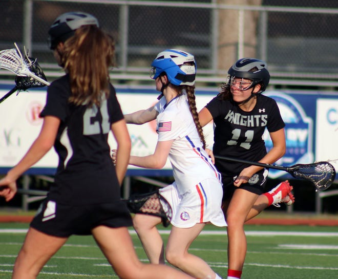 Creekside attacker Carsyn Christel shoots through traffic for a goal against Bolles in the Rivalry on the River girls lacrosse tournament on Thursday.