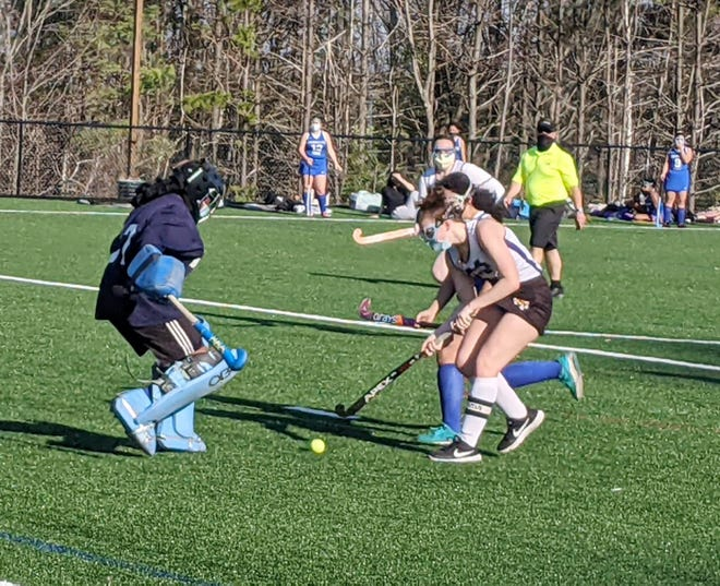 Monty Tech forward Frankie Alley attacks against Worcester Tech goaltender Stacia Zaghbi during Friday afternoon's game at Game On in Fitchburg.
