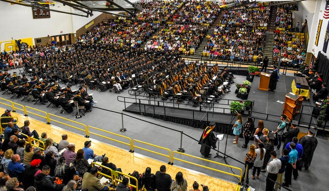 Garden City Community College students graduating, staff and family and friends fill the Perryman Athletic Complex gym in May 2019 for commencement.  After a strictly virtual graduation in 2020 due to the COVID-19 pandemic, GCCC will hold the 2021 graduation in-person with limited seating.