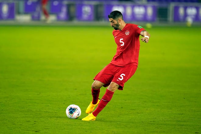 Canada defender Steven Vitoria (5) passes the ball during the first half of a World Cup 2022 Group B qualifying soccer match against Bermuda, Thursday, March 25, 2021, in Orlando, Fla. (AP Photo/John Raoux)