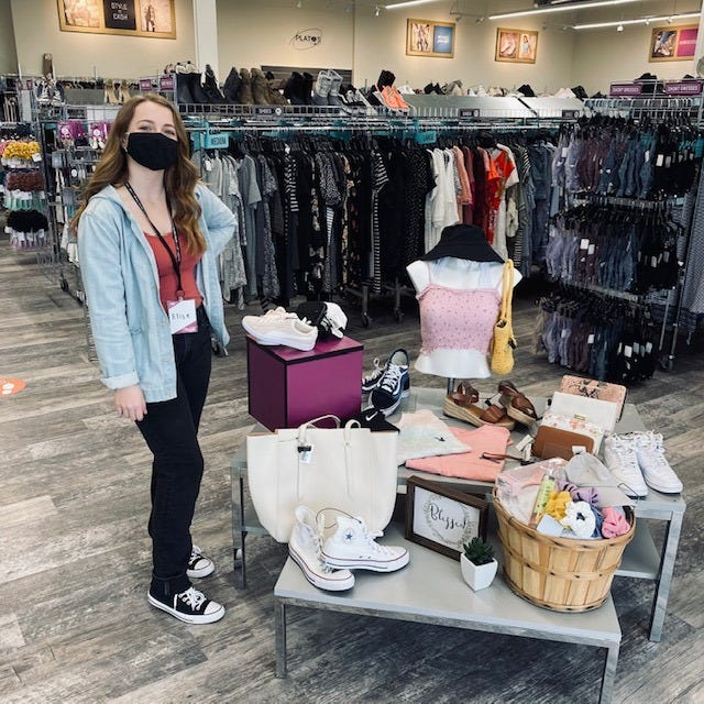 An employee poses for a photo at Plato's Closet in Holland Township. The store on W. Shore Drive will open its doors to buyers Thursday, April 1, during a grand opening celebration.
