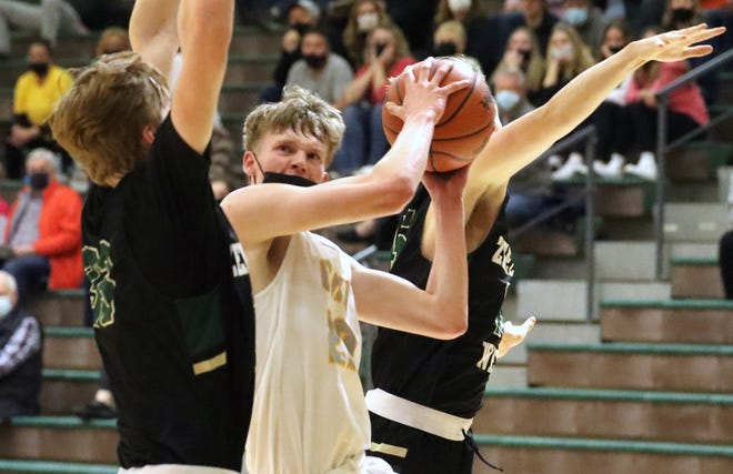 Brandon Claerbaut drives to the hoop during Zeeland East's win over Zeeland West on Thursday, March 25, 2021