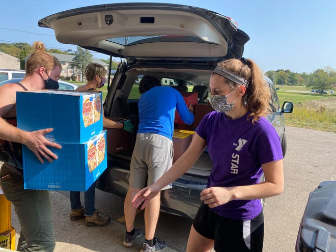 Volunteers collect cereal during a food drive through Allegan County Food Pantry Collaborative. This year's cereal drive will begin Thursday, April 1.