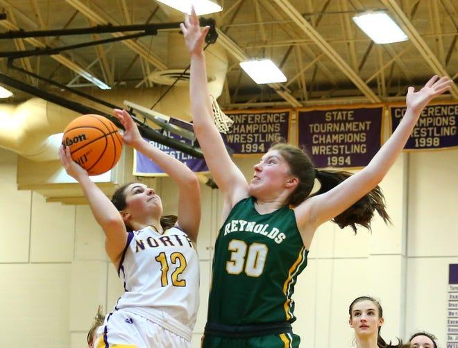 North Henderson's Lexie Gunter (12) shoots the ball against A.C Reynolds' Sarah Fletcher during a game last season.