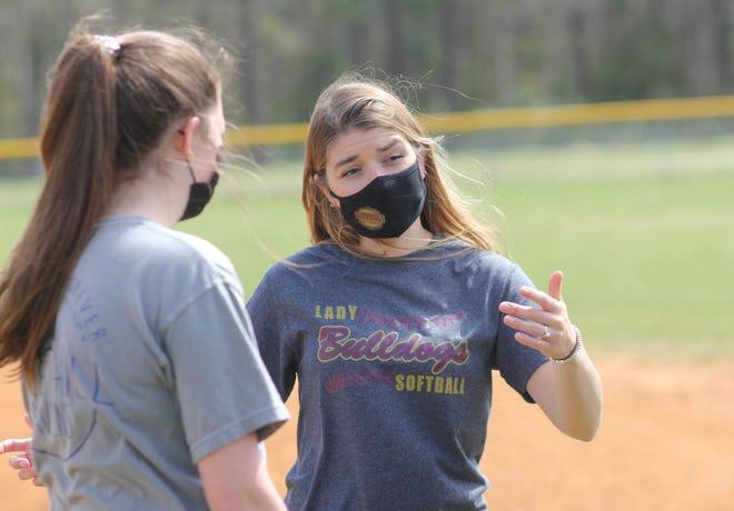 Dixon coach Christina Drake talks to a player during a recent practice.