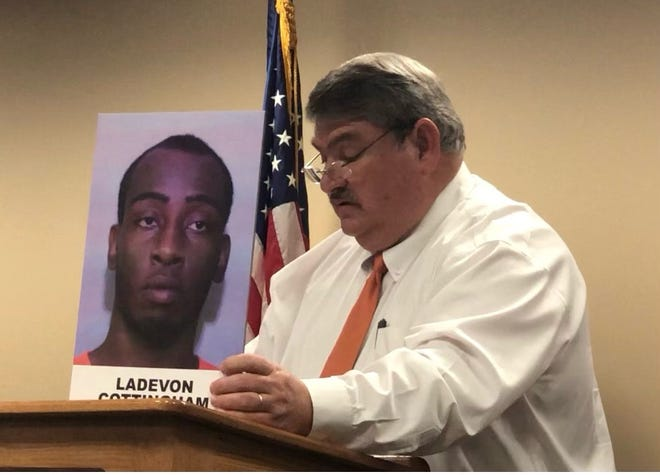Lakeland Police Assistant Chief  Sam Taylor announces a grand jury indictment against Ladevon Cottingham, 22, on Friday in the deaths of Takeria Adderly and Ricky Kimball.