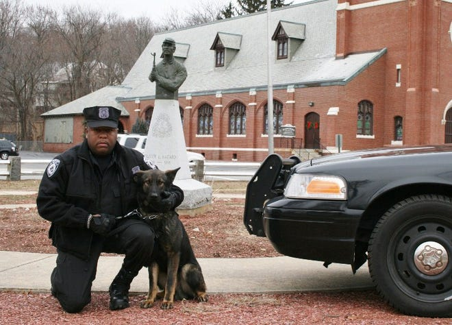 Leominster Police Officer Randy Thomas and K-9 officer Justice are seen in this 2014 photo.