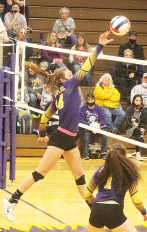 Fowler High School's Emerson Mason hits the ball over the net in Thursday's match against Swink. Mason had 10 kills as the Grizzlies defeated the Lions in three sets.