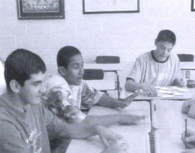 Pictures of the Past is from the 2002 Lincoln Community High School yearbook. The photo shows students just hanging out at the school. From left are: Michael McClellan, Tim Reddix and Justin Ash who were discussing their social studies lesson.