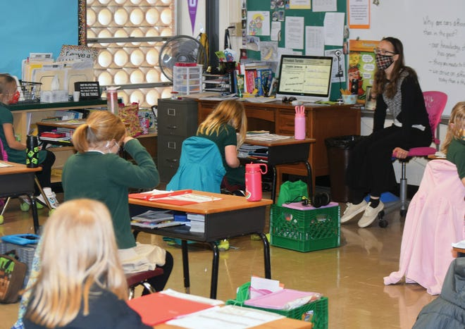 Teachers and students at Xavier Catholic School have made adjustments because of the COVID-19 pandemic.