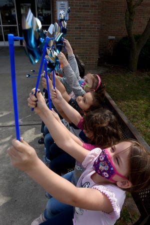 Sterling Elementary preschoolers enjoyed lifting the pinwheels while the wind was blowing that were give to them by the school before posting colorful pinwheels into the ground as part of the Child Advocacy Network of Monroe County program this past Thursday.