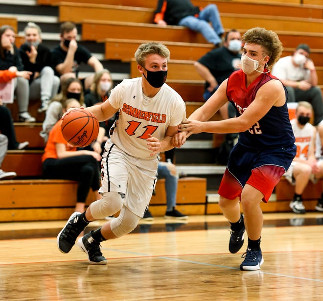 Devin Albain of Summerfield (left) looks to play past Hunter Wynn of Britton Deerfield on Thursday, March 25, 2021 in the Division 4 District finals.