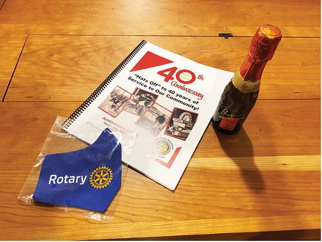 Gifts to members celebrating 40 years as a Rotary Club