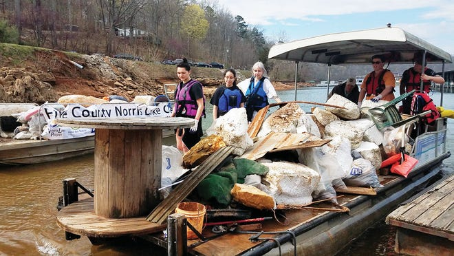 This picture shows an earlier cleanup effort on Norris Lake last Spring. Special to The Oak Ridger
