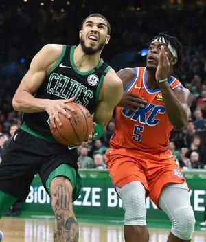 Thunder guard Lu Dort defends Celtics forward Jayson Tatum.
