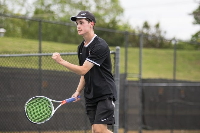 Crossings Christian's Daniel Haley pumps his fist during the tennis state championships at OKC Tennis Center on May 11, 2019.