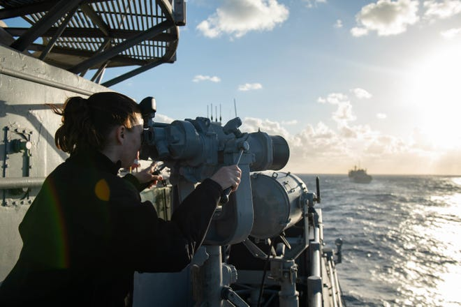 Logistics Specialist 2nd Class Angela August of Ocala looks through binoculars aboard the Ticonderoga-class guided-missile cruiser USS Monterey on March 17.