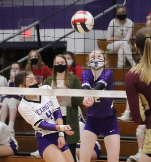 Erin Kelley (4) of Lexington tries to avoid teammate Rachel Olson as the libero bumps the ball during Thursday's Heart of Illinois Conference volleyball match at The Fort.