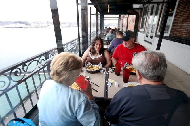 From left, Lisa Ouellet enjoys lunch with her parents and Ben Betterley at River House on Friday afternoon in Portsmouth.