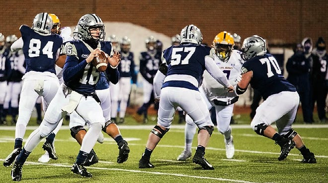 UNH quarterback Matt Brosmer drops back to pass in the team's season-opening loss to Albany on March 5. The Wildcats have had their next two games cancelled and are scheduled to play at the University of Rhode Island next Saturday.