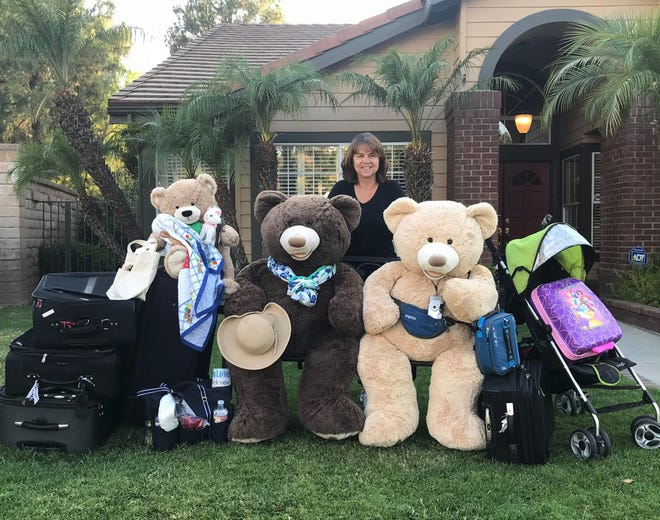 Laura Snyder and her bear family waiting for an 'ubear'  in Yorba Linda, California on July 6, 2020.