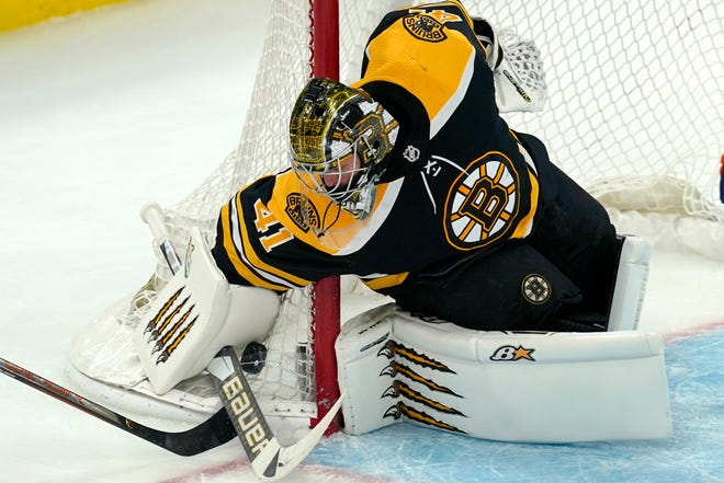 Boston Bruins goaltender Jaroslav Halak (41) traps the puck with his stick against the outside of the net in the third period of an NHL hockey game against the New York Islanders, Thursday, March 25, 2021, in Boston. (AP Photo/Elise Amendola)