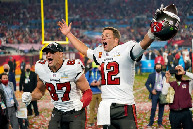 Tampa Bay Buccaneers tight end Rob Gronkowski and quarterback Tom Brady exult after the Bucs' Super Bowl victory Feb. 7.