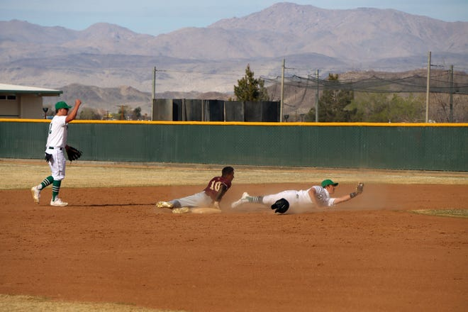 All eyes are on the umpire after a close throw to second base followed by an impressive tag led to the Burros picking off the Saints' runner.